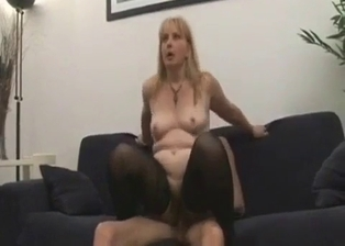 Big-boobed blonde swallows her son's dick