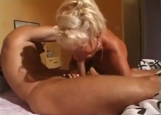 Blonde MILF blows her cousin in the bedroom